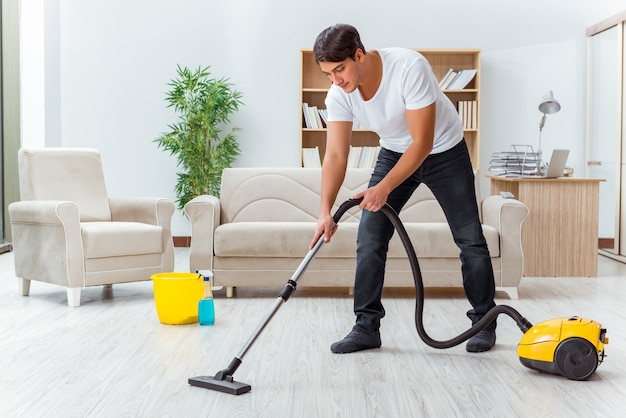 Man husband cleaning the house helping wife Premium Photo