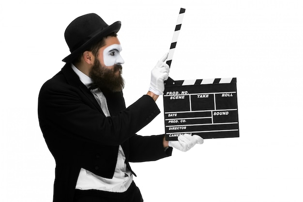 Man in the image mime with movie board Free Photo