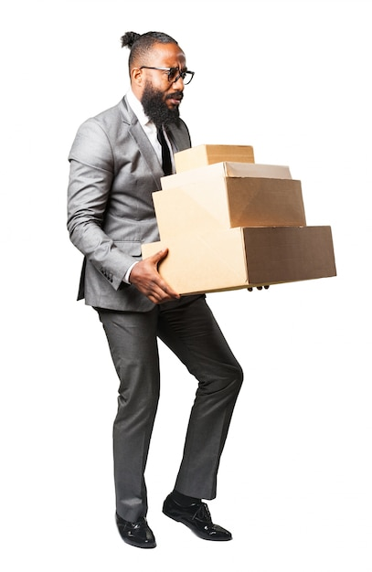 Man in suit with lots of boxes Free Photo