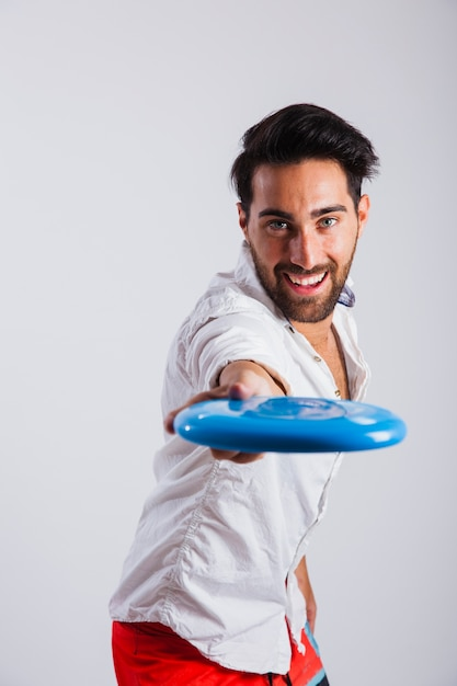 Man in summer wear holding frisbee close up view Free Photo