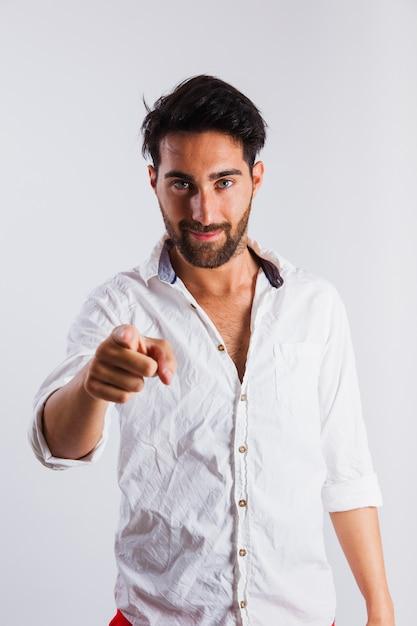Man in summer wear making pointing gesture Free Photo