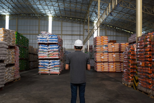 A man is checking the product quality in the warehouse. warehousing, quality control Premium Photo