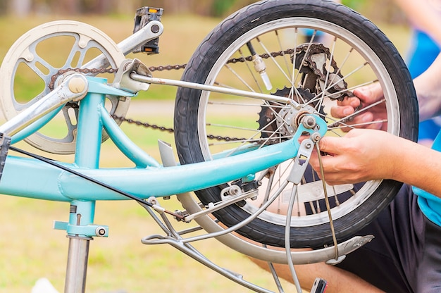 Man is fixing bicycle, selective focused. Free Photo