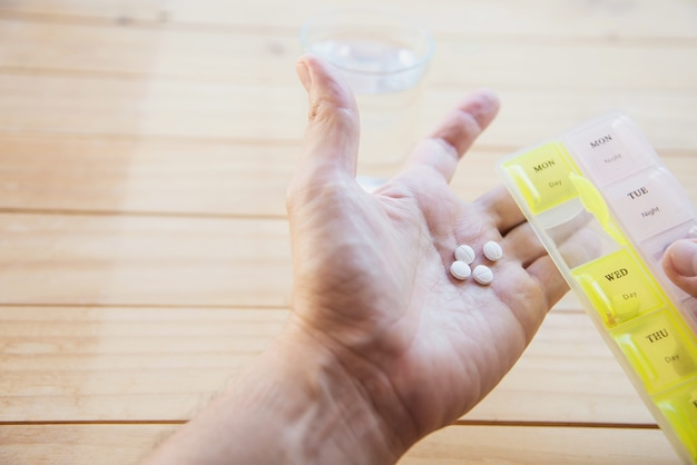 Man is going to eat medicine tablet Free Photo
