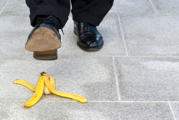 A man is going to step on a banana peel Free Photo