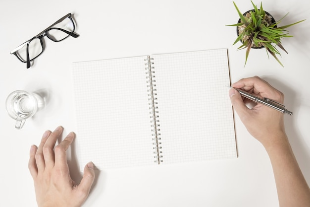 Man is going to write something on his notebook. top view, flat lay. Premium Photo