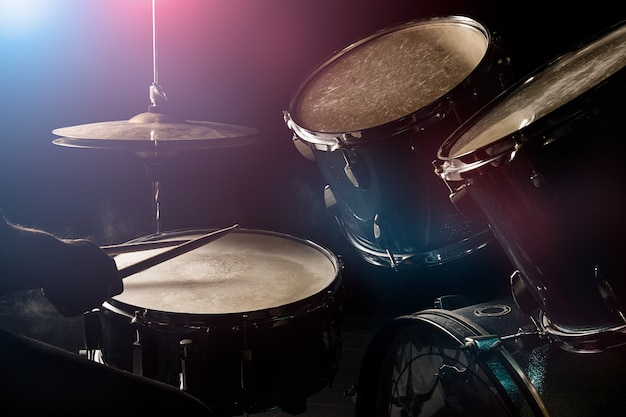 The man is playing drumset Premium Photo