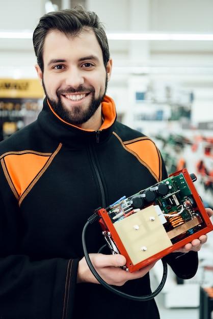Man is posing with uninterruptible power supply. Premium Photo