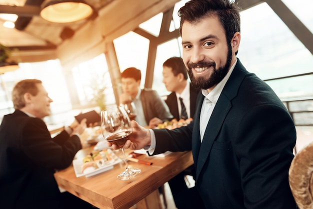 Man is posing with wine glass. Premium Photo