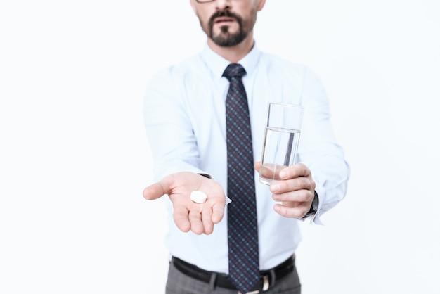 Man is sick, he has different medications in his hands. Premium Photo