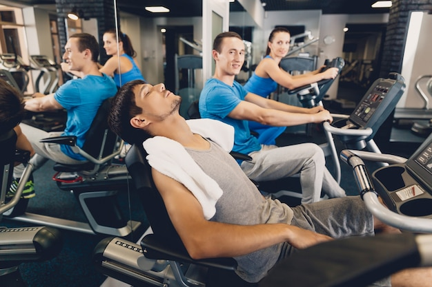 A man is tired after physical training on cardio Premium Photo