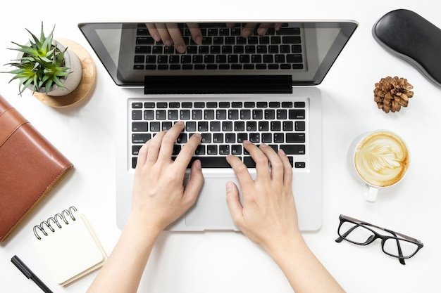 Man is typing on laptop keyboard. top view. Premium Photo