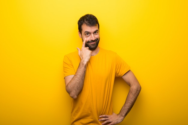 Man on isolated vibrant yellow color looking to the front Premium Photo