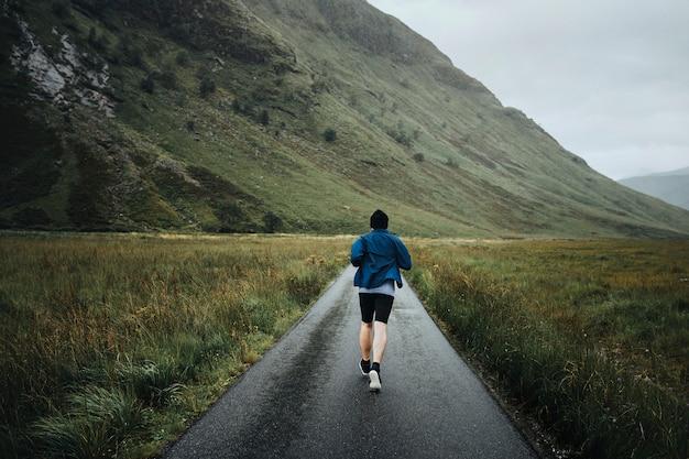 Man jogging through the highlands Premium Photo