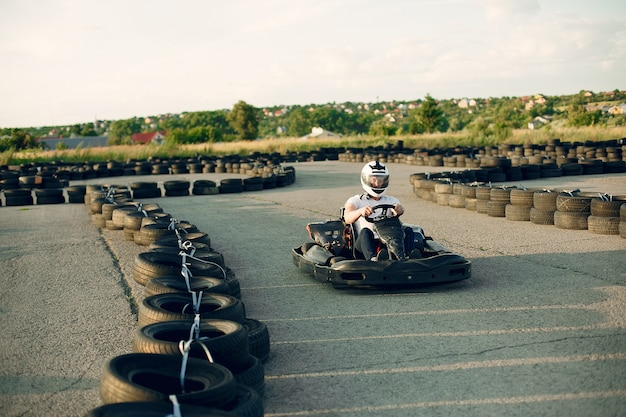 Man in a karting circuit with a car Free Photo