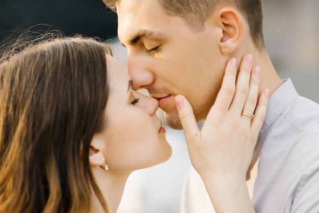 A man kisses his woman's nose, close-up kiss Premium Photo