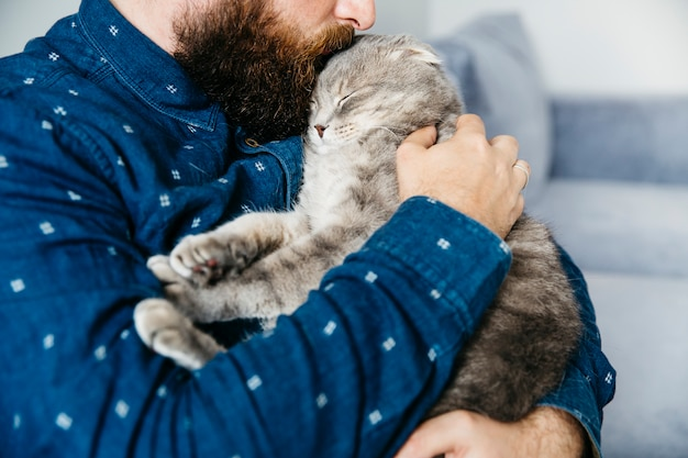 Man kissing adorable cat Free Photo