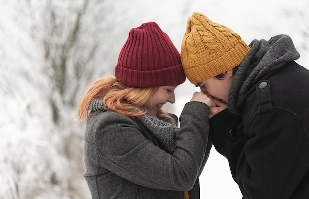 Man kissing her girlfriend's hands Free Photo