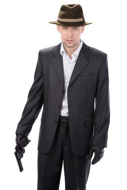 Man in leather gloves and suit and gun. Premium Photo