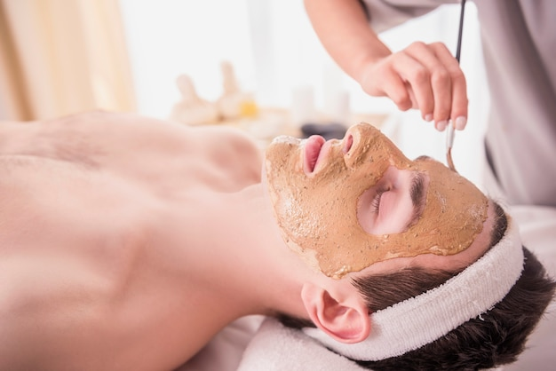 Man lies on the bed and they put a mask on his face. Premium Photo