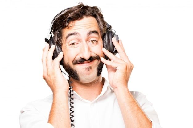 Man listening to music with headphones black Photo | Free ...