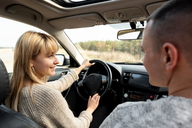 Man looking at  beautiful wife driving Free Photo