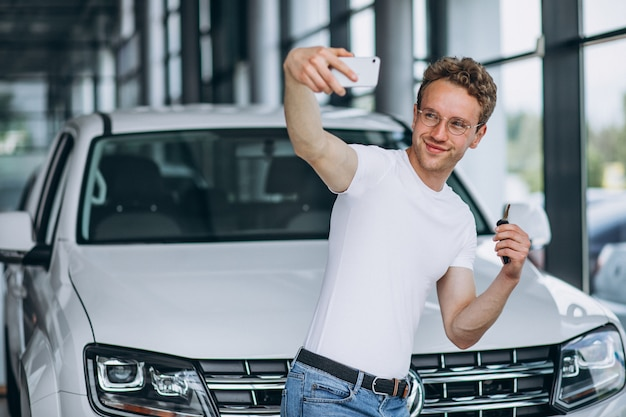 Man looking for a car in a car showroom Free Photo