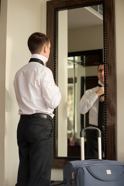 man looking into a mirror photo free download