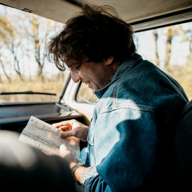 Man looking at a map for new locations Free Photo