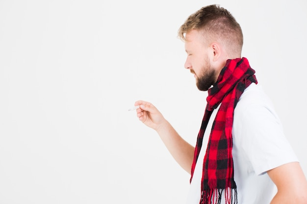 Man looking at mercury thermometer Free Photo