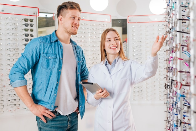 Man looking for new glasses at optometrist Free Photo