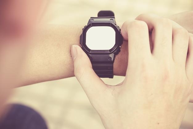 Man looking smartwatch Free Photo