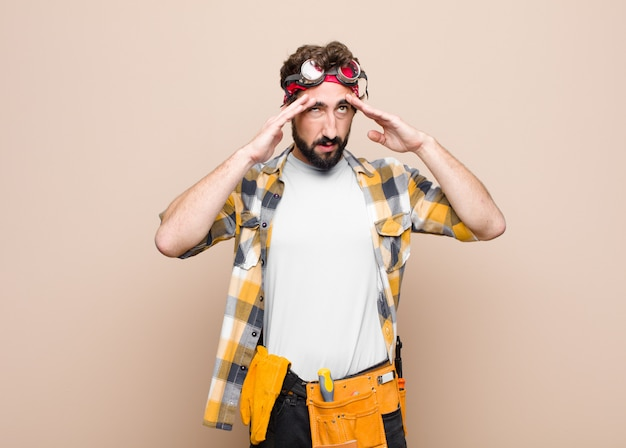 Man looking stressed and frustrated, working under pressure man with a headache and troubled with problems Premium Photo
