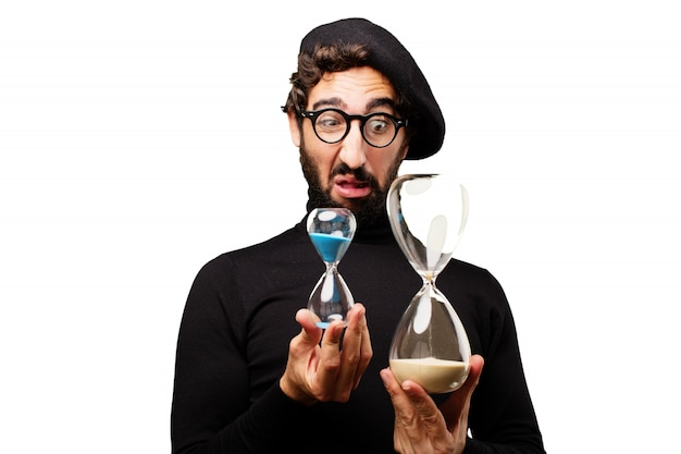 Man looking at two hourglasses Free Photo