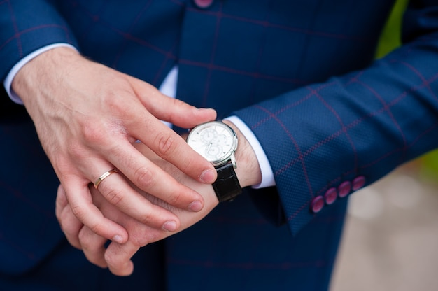 A man looks at his watch Premium Photo