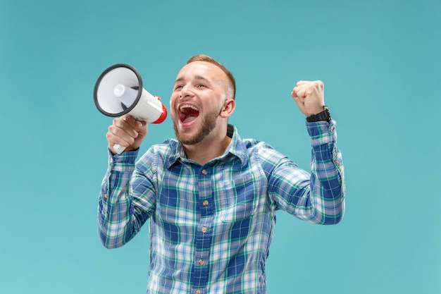 Man making announcement with megaphone Free Photo
