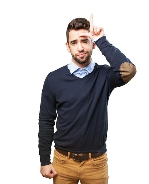 Man making gesture loser | Free Photo
