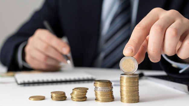 Man making a graph with a bunch of cents Premium Photo