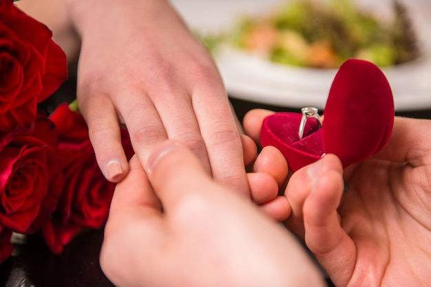 Man making proposal with the ring to his girlfriend. Premium Photo