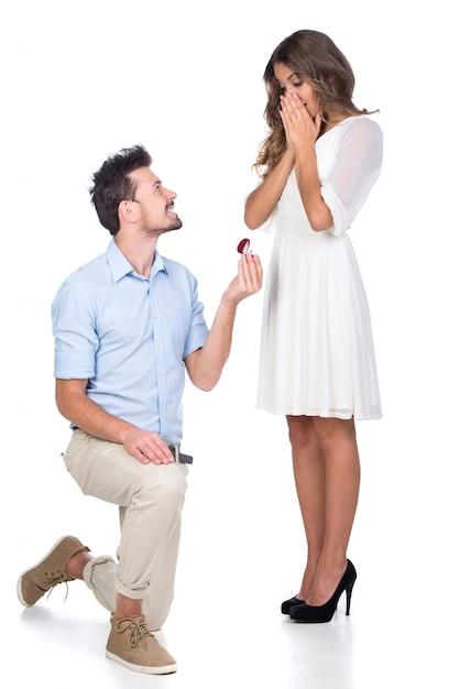 Man making propose with wedding ring in gift box. Premium Photo