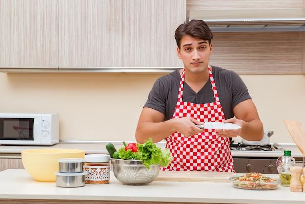 Man male cook preparing food in kitchen Premium Photo
