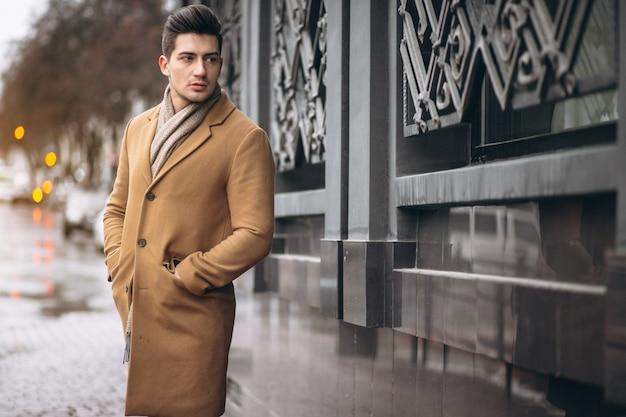 Man model in coat outside Free Photo