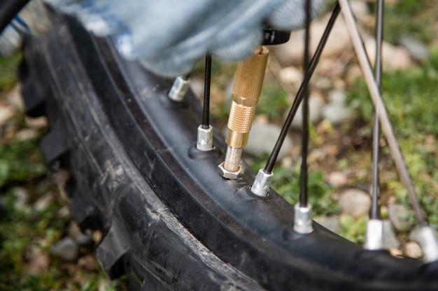Man motorcycle tire manual air pressure testing Premium Photo