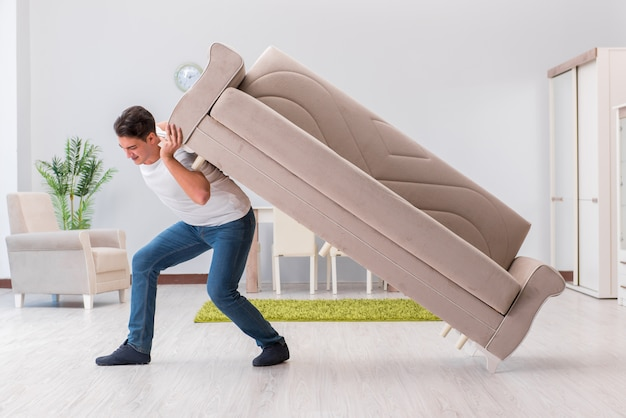 Man moving furniture at home Premium Photo
