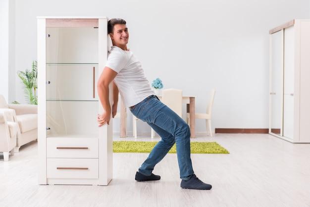 Man moving furniture at home Premium Photo