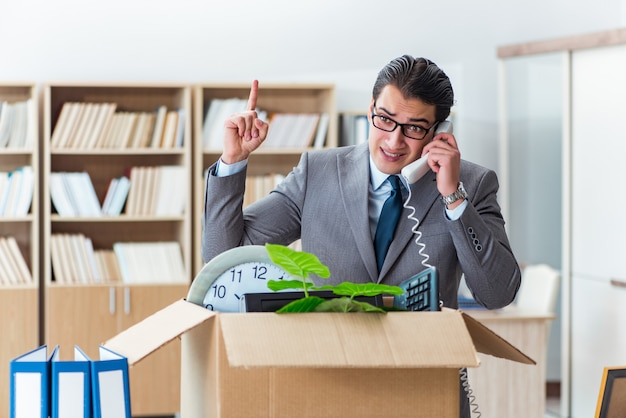 Man moving office with box and his belongings Premium Photo