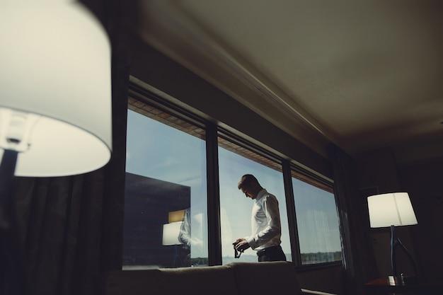 Man near window Free Photo