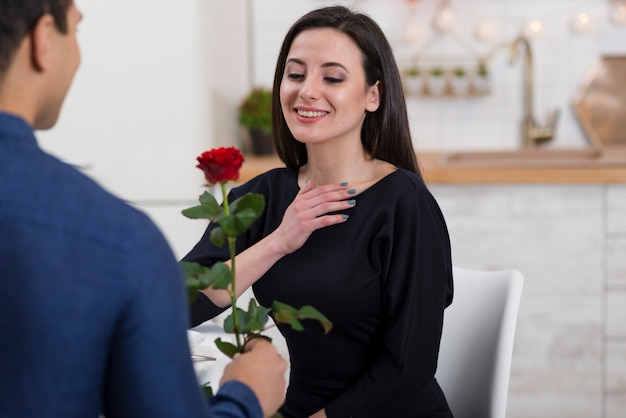 Man offering his girlfriend's a rose Free Photo