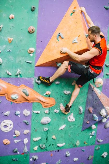 Man on climbing wall ledge 23 2147795570