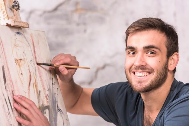 Man painting at home Free Photo